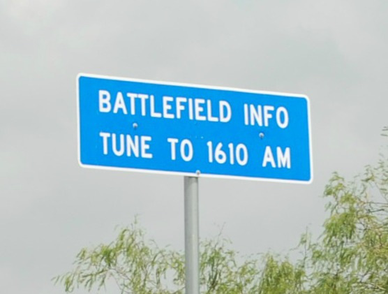"Road sign reading, ""Battlefield Info Tune to 1610 AM."""