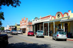 A view of cars and buildings in downtown Bastrop, Texas