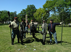 Reenactors pose with cannon