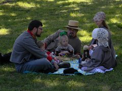 Family gathers together on the lawn