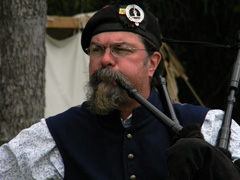 Reenactor plays bagpipe