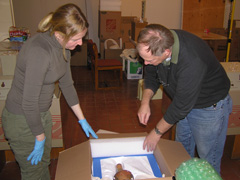 Staff prepared packing cradles for moving artifacts.