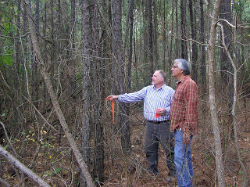 Tony Souther and Phil Cross in forest by Caddo Mounds State Historic Site.