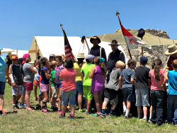 Buffalo Soldier reenactors talk to students.