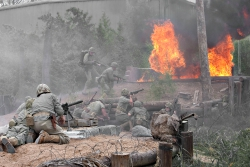 Battle reenactment at the National Museum of the Pacific War's Pacific Combat Zone