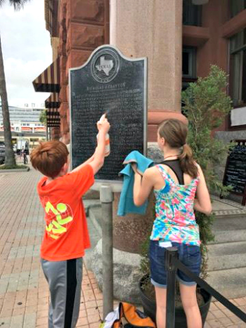 Finn and Avery Taylor refinish historical marker