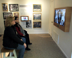 Visitors watch video