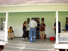 People enjoy refreshments on the porch