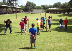 Campers use stilts on the lawn