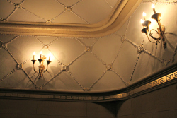 Wall sconces and decorative plaster wall treatments