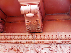 Decorated corbel and carved details on the terra cotta facade during restoration.