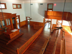 View of the restored District Courtroom from the reconstructed balcony.