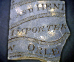 Importer mark on ceramic sherd.