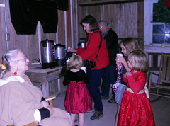 Guests serve themselves refreshments.