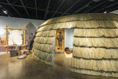 The grass house exhibit inside the Caddo Mounds visitors center.