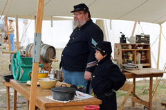 Reenactors making food