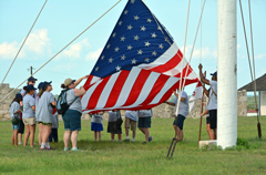 Campers raise the flag each morning.
