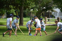 Campers play a game of shinny.