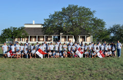 Campers pose for a photo in front of Fort McKavett