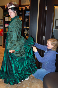 Site Manager Marsha assists with Lara's bustles.