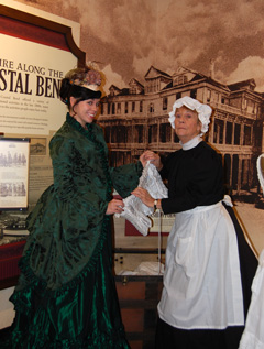 Two women dressed in Victorian clothing.