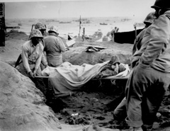Marines carrying wounded on stretchers