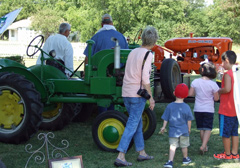 Visitors view the tractors on display.