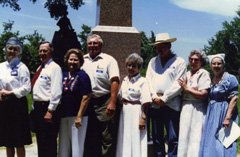 Descendants stand in front of SFA monument