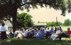 Descendants gather for a meeting on the lawn