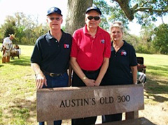 "Three people standing behind granite bench engraved with ""Austin's Old 300"""