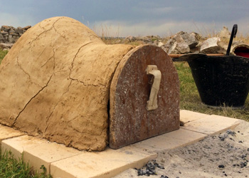 A preheated adobe oven ready for baking.
