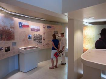 Visitors view the Battle of Coleto Creek exhibit at Fannin Battleground.