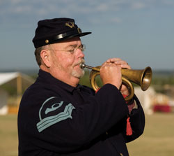 Soldier plays the bugle.