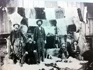 Col. Black (standing in the center) with a selection of the quality of hides from his tannery in Fort McKavett.