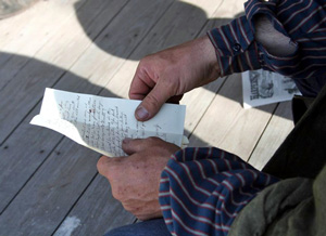 Man holds a letter in his hands.