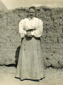 Octavia Magoffin outside the Magoffin Home courtyard, ca. 1905.