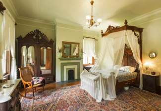 The master bedroom in the Starr Family Home.