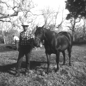 Hogg family ranch foreman Hal Fields with his beloved horse Buster, 1950s