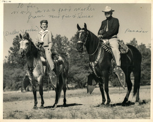 Tom Hogg and his wife, Margaret, with two of their equine friends.