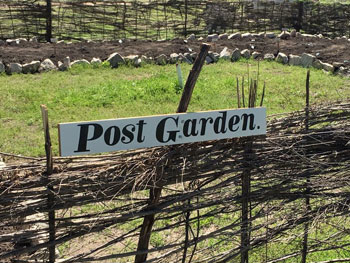 "The modern post garden was built on the east side of the Commanding Officers Quarters and is enclosed in a woven ""wattle"" fence made from willow branches"