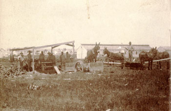 Ragsdale photo showing soldiers of the 10th Infantry operating a mule-driven sawmill at Fort McKavett circa 1875.
