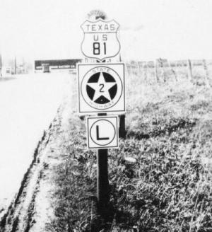 Circa late 1920s highway signs in Montague County, photo courtesy TxDOT