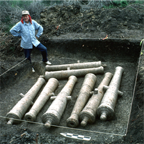 Former THC Director Curtis Tunnell inspecting the 8 cannon from Fort St. Louis buried by the Spanish