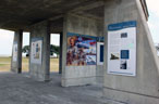 Exhibit posters on concrete walls outdoors