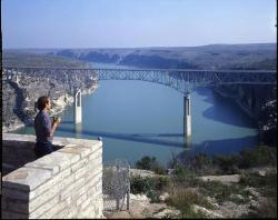 Man views high bridge and historic Pecos River Bridge in Val Verde County; photo courtesy TxDOT.