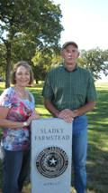 Couple standing next to a Historic Texas Lands Plaque