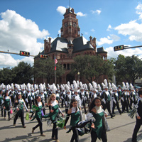 Band parades in front of the courthouse.