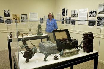 Visitor looks at exhibit at Sam Rayburn House.