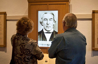 Visitors look at an exhibit about Jose Antonio Navarro.