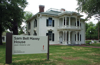 "Victorian style house with a sign in front saying ""Sam Bell Maxey House: State Historic Site"""